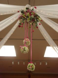 A Floral Chandelier with Hanging Kissing Balls from a 20 foot ceiling...a beautiful challenge.