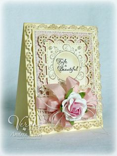 I have these Martha Stewart punch around the page punches--It is a good chance to use them for this feminine card