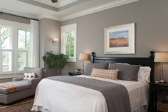 About this gray bedroom the walls are painted a medium warm gray