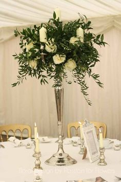 Candelabra with avalanche roses by www.passionforflowers.net