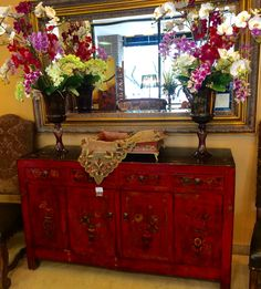 Hand painted red and black console table with silk flowers and gold mirror Closetconnoisseurresale.com #saresale #SanAntonioresale #bestresale #consignment #closetconnoisseur  #closetconnoisseurresale #homedecor #homedecoration #art #furniture #jewelry