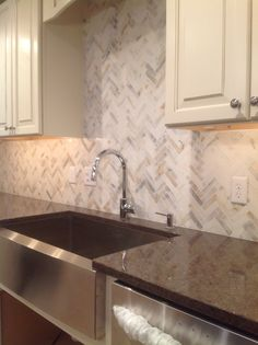 Stainless Farm Sink U0026 Calacatta Gold Marble Herringbone Backsplash With  Awesome Faucet And Brown Quartzite Counter