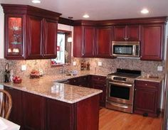 awesomebrandi: Kitchen layout similar to our current one, cherry cabinets, granite backsplash, like the ...