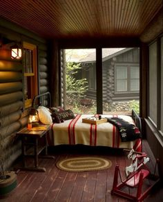 Content in a Cottage ~ An  iron bed with a striped wool blanket out on the porch ~