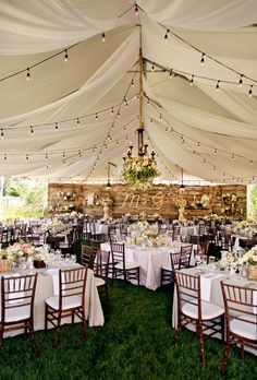 Beautiful Wedding Tent Ideas: Rustic Tent with Wooden Accents | Brides.com
