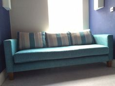 Bespoke Retro sofa - with one base and three back cushions.  We used Fama's plain and striped fabrics to coordinate with the customer's swivel snuggler they also commissioned from us.