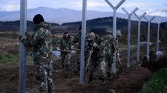 Macedonian army build a border fence to prevent illegal crossings by migrants, in the Greek-Macedonian border near the Greek village of Idomeni on Saturday, Nov. 28, 2015. Macedonia toughened rules for crossings earlier this month, in the wake of the deadly Paris attacks, restricting access to citizens from countries typically granted asylum in Europe, including Syria and Afghanistan. (AP Photo/Giannis Papanikos)