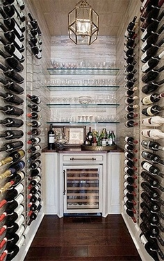 Wine cellar    Sophisticated collectors will appreciate the visual simplicity of this floor-to-ceiling wine storage display. Equally appealing are its perfectly shelved glassware and stained wood floors.