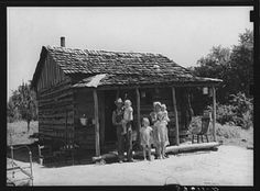 9. This tenant farmer, wife and 3 children are standing in front of their home in Sallisaw.