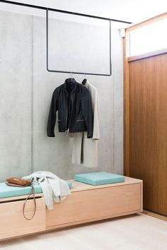 Entryway with clothing rack in steel and a wooden bench. The clothing rack has LED lights in the rear that glows the concrete wall up. Hall Interior Design, Contemporary Interior Design, Interior Design Inspiration, Modern Interior, Decoration Hall, Entryway Decor, Vestibule, Luxury Furniture, Furniture Design