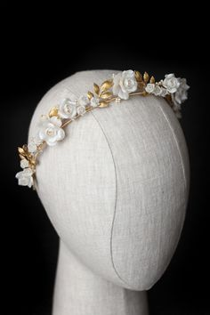 We had the pleasure of working with bride Angela to create a decadent and indulgent crown for her wedding day, Crown of Roses. This bespoke beauty makes a bold statement of regality and romance with its charming vine-like silhouette adorned in detailed clay roses and a soft scattering of pearl elements. Angela's bespoke journey started […] Headpiece Wedding, Wedding Veils, Bridal Headpieces, Bridal Hair, Wedding Crowns, Wedding Day, Silver Wedding Jewelry, Bridal Looks, Wedding Hairstyles