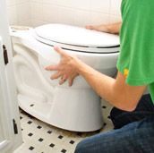 Replacing A Toilet - This site has TONS of home improvement DIY