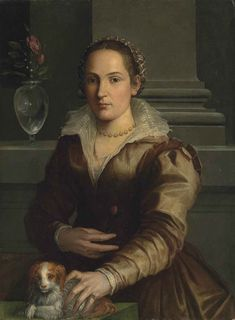 Portrait of a Lady in a rust dress with a small dog Studio of Alessandro Allori