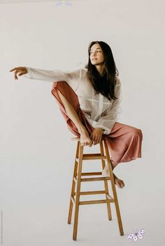 babybifunow Woman Model Posing on A Stool in Culottes and a Raincoat by Rachel Gulotta Photo... -  Woman Model Posing on A Stool in Culottes and a Raincoat by Rachel Gulotta Photography for Stocksy  - #AngelinaJolie #BeautifulCelebrities #CelebrityPhotos #culottes #Gulotta #model #photo #posing #rachel #raincoat #stool #woman<br>