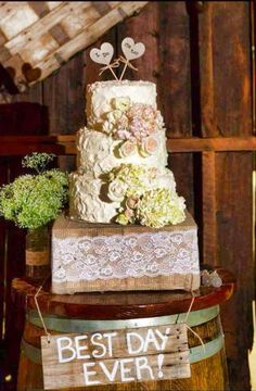 Set the cake on a box wrapped in burlap and lace