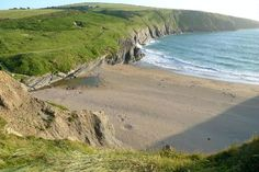 Mwnt, Cardigan Bay, Wales - Best Family-Friendly Beaches in the UK Slideshow at Frommer's Quay West, Welsh Cottage, Irish Sea, Great Britain, Beautiful Landscapes, Wales, Places To See, Coast, Cymru