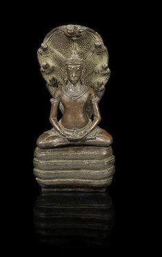 A Khmer bronze seated figure of Buddha Muchalinda Cambodia, late 12th/ early 13th Century