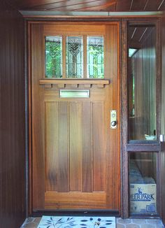 """Craftsman Door Collection by Decora. This is a 36"""" x 80""""Custom Mahogany Craftsman Door.The door features 3 divided lites with insulated leaded stained glass in a Frank Loyd Wright designover 3 flat panels. Under the glass is a large ledge with dental molding. The door was finished with a cherry stain and has a Baldwin Reading 6551-151 handle set and Baldwin mail slot."""