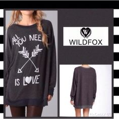 """HP Wildfox Oversized Sweater Wildfox """"All you need is love"""" Oversized charcoal gray sweater. Can also be styled as a dress/tunic. Polyester rayon and spandex material blends. PRICE FIRM ❣ Wildfox Sweaters"""