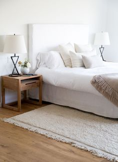 Hunter worked with interior designer Caroline Wolf on the master bedroom. The bedspread is from Matteo, and all the throw pillows are from Jenni Kayne Home: a Linen Seam Rectangle Pillow ($115) plus alpaca stripe pillows in Square and Rectangle ($195 each). On the bed is the Alpaca Basketweave Throw Blanket in oatmeal; $295. The Orb Vase on the nightstand is by Victoria Morris; $300.