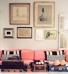 Salmon pink sofa and gallery wall...Not sure about color of couch but love the wall...