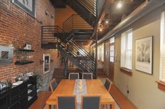 Rehabbed Baltimore home features exposed brick walls and floating staircases.