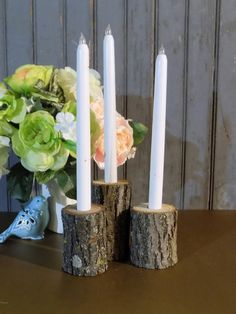 Set of 3 Rustic Log Tapered Candle Holders. Looking to add some texture to your space? Whether you live in the county or your home is in the city, you don't have to live in a barn to embrace rustic co