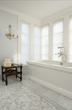 like the windows surrounding the tub, basketweave tile rug in front (not the greek key border, though).