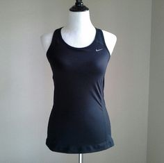 Women's Training Tank Top Dri-FIT fabric helps keep you dry and comfortable Engineered mesh provides comfortable cooling Nike Tops Tank Tops