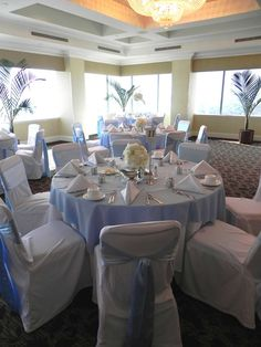 Light Blue wedding....light blue tablecloth with white chair covers blue sash