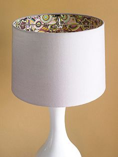 Surprise Lining - A surprise paper lining is perfect for a contemporary lamp. It looks great when the lamp is off and even better when the lamp is on! Cut decorative paper to fit inside the shade. Attach it with double-stick tape