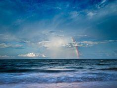 """Looking to the rainbow"" by Khantipol (kktp_) on Flickr. #khantipol #kktp_ #photography #sky #clouds #ocean #sea #waves #beach #water #blue #rainbows #rain #white #nature #thailand"