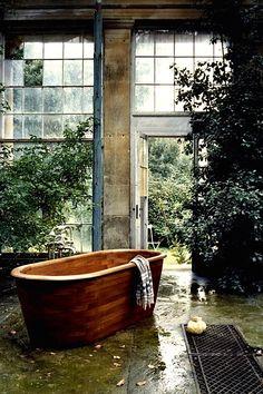 Tub in the conservatory:  Ship Shape Teak Bathtub    ©    Robert D'Costa   