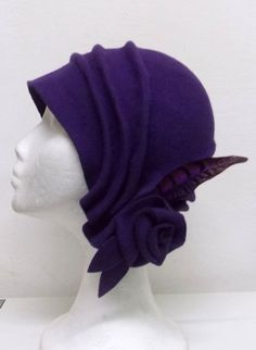20s vintage style cloché hat made in 100% wool felt, modelled and created totally by hand, with nice draped and lateral flower with a phaesant