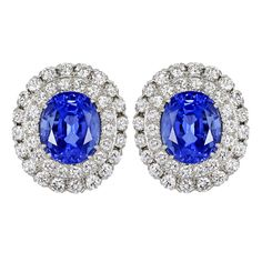 David Webb Sapphire Diamond Earrings Platinum cluster earrings consisting of 2 oval shaped sapphires having a total weight of 26.58 carats set with 45 round brilliant cut diamonds having a total weight of 4.50 carats.