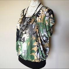 SALE Blouse  NWOT Green, black, white, tan, gray, yellow, beige multi color print on silky fabric (polyester/spandex). New- never worn. Perfect condition. Ladies size Large. Tops Blouses