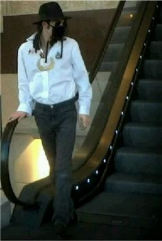 Michael Jackson coming off the escalator way to much sexyness on one escalator lol