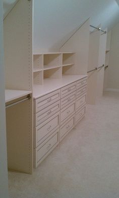 Built in closet sloped ceiling. This is almost perfect for upstairs- just instead of an extra closet, modify it for all my craft supplies.