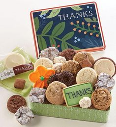 Send your thanks with a gift tin of Cheryl's famous individually wrapped buttercream frosted cookies including flavors like salty caramel, our thank you wrapped vanilla cut-out cookies and cheerful flower cut-outs along with snack size gourmet cookies and brownies and our fudgy truffle cookies. Thank You Cookies, Cut Out Cookies, Bakery Business, Business Gifts, Cookie Frosting, Buttercream Frosting, Frosted Cookies, Flower Cut Out