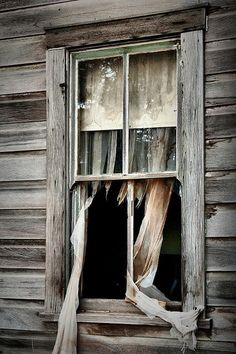 perfect, broken windows and tattered curtains!