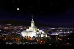 Three temples by moonlight. The Draper Temple in the foreground with the the Jordan River Temple off to the right in the distance and the Oquirrh Mountain Temple in the distance to the left.