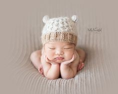 The most adorable little crochet kitty hat pattern!  I love the elegant texture of the Smock Stitch...and combined with those cute little ears!?  Must make this pattern now.