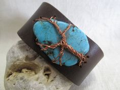 Hey, I found this really awesome Etsy listing at https://www.etsy.com/listing/221645908/brown-leather-cuff-copper-wrapped