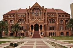 The Ashbel Smith Building, also known as Old Red, is a Romanesque Revival building located in Galveston, Texas. It was built in 1891 with red brick and sandstone. Nicholas J. Clayton was the architect. It was the first University of Texas Medical Branch building.