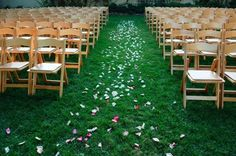 Wooden folding chairs give a great summer feel to an outdoor wedding