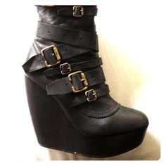 Aldo boots. Size 39 or 9. These things are wicked, if keep them if my boyfriend was taller!!! Beautiful, I've only worn a handful of times. Size 9 but Aldo runs a bit small. Black wth bronzeish buckles. I'd guess about 5 inch heel. You will feel fierce! Trust me!! ALDO Shoes