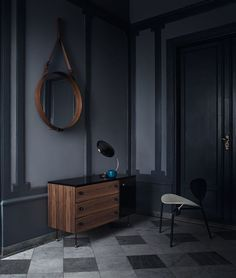 GUBI // Adnet circulaire mirror L in tan, Cobra table lap in black, Grossman Dresser and Nagasaki chair on white/black