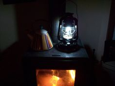 The image is of the Stove Lite Basic running on a Wood Stove in South Royalton, Vermont. The Stove Lite Basic is a Thermoelectric Lantern that runs off the Heat of a Wood Stove. Thermoelectric Generator, Wood Burning, Vermont, Stove, Lanterns, Running, Lighting, Image, Home Decor