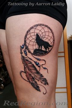 Dreamcatcher with wolf tattoo