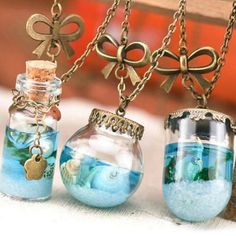 When Mermaids are sad and need to cry, they approach the shore. They drop their tears in tiny bottles and leave them in the rocks to forget their pain for ever. We decided to make necklaces with their